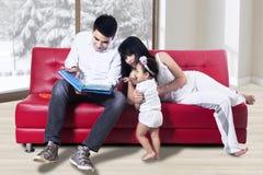Happy family reading story Royalty Free Stock Photo