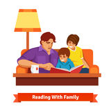 Happy family reading together. Mother, father, son Stock Image