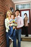 Happy family with real estate agent. Real estate agent with family welcoming to new home Stock Photos