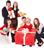 Happy family with red gift box. Royalty Free Stock Photo