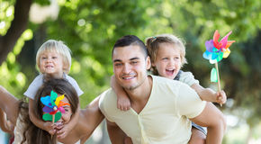 Happy family relaxation in park Stock Photos