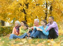 Happy family relaxing in autumn forest Stock Images