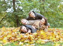 Happy family relaxing in autumn park Stock Photography