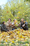 Happy family relaxing in autumn park Stock Photo