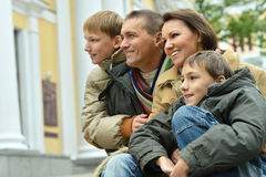 Happy family relaxing in autumn park Royalty Free Stock Photos