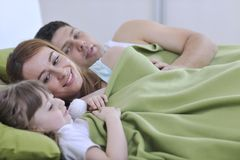 Happy family relaxing in bed Royalty Free Stock Images