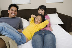 Happy Family Relaxing In Bedroom Royalty Free Stock Image