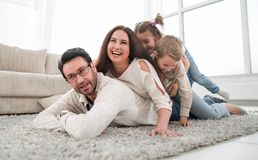 Happy family relaxing in comfortable living room royalty free stock photography