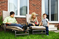 Happy family relaxing at home stock images