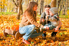 Happy family relaxing outdoors. In autumn park Royalty Free Stock Image