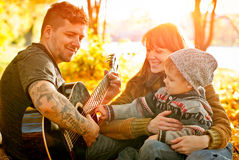 Happy family relaxing outdoors Royalty Free Stock Photos