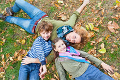 Happy family relaxing outdoors In park. Happy family relaxing outdoors In autumn park stock photography