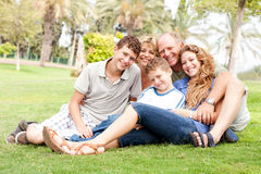 Happy family relaxing in the park Stock Images