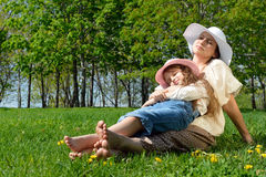 Happy family relaxing in the park Stock Photo