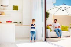 Happy family relaxing on rooftop patio with open space kitchen at warm summer day. Happy family relaxing on rooftop patio area with open space kitchen at warm Royalty Free Stock Photos