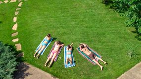Happy family relaxing by swimming pool, aerial drone view from above of parents and kids have fun on vacation, family weekend stock images