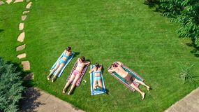 Happy family relaxing by swimming pool, aerial drone view from above of parents and kids have fun on vacation, family weekend stock photos