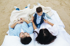 Happy family relaxing together on the mattress Stock Photography