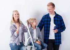 Happy family during renovation Stock Photos
