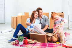 The happy family  during repair and relocation Royalty Free Stock Images