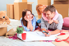The happy family  during repair and relocation Stock Photography