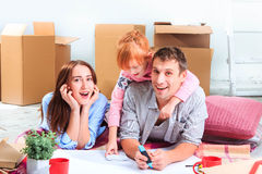 The happy family  during repair and relocation Stock Image