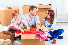 The happy family  at repair and relocation Stock Images