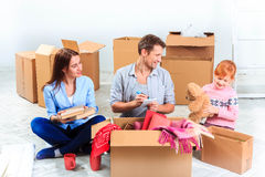 The happy family at repair and relocation stock image