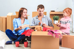 The happy family  at repair and relocation Royalty Free Stock Image