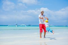 Free Happy Family Resting At Beach In Summer. Father With Son Resting On The Beach. Father And His Adorable Little Son On Royalty Free Stock Photos - 119305528