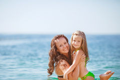 Happy family resting at beach in summer Royalty Free Stock Photo