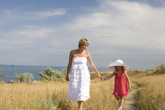 Happy family resting at beach in summer mother with daughter Royalty Free Stock Photography