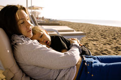Happy family resting at beach in summer mother with daughter Stock Photography