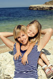 Happy family resting at beach in summer mother with daughter Stock Images