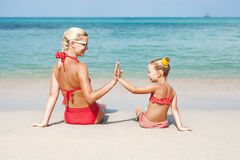 Happy family resting at beach in summer Stock Photography