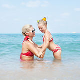 Happy family resting at beach in summer Stock Image
