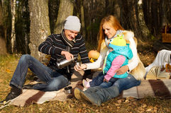 Happy family resting on the nature Royalty Free Stock Photos