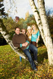Happy Family Resting Outdoors during a nice day in fall season Royalty Free Stock Images