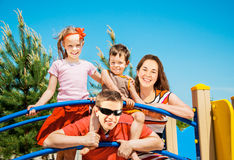 Happy family resting outdoors Stock Photography