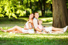 Happy Family Resting In The Park Royalty Free Stock Photos