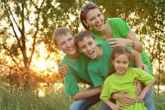 Happy family resting in park Stock Photo