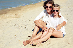 Happy family resting on a sandy beach Royalty Free Stock Photos