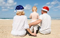 Happy family resting on the sea Stock Photos