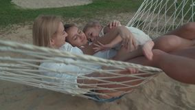 Happy family rides emotionally on hammock slow motion stock footage video stock footage