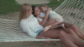 Happy family rides emotionally on hammock stock footage video stock footage