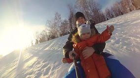 Happy family rides and smiling snowtube on snowy roads.slow motion. snow winter landscape. outdoors sports stock video footage