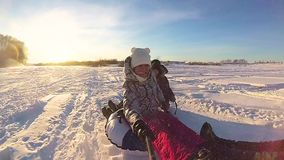 Happy family rides and smiling snowtube on snowy roads.slow motion. snow winter landscape. outdoors sports.Sunset stock footage