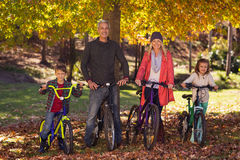Happy family riding bicycles at park Royalty Free Stock Image