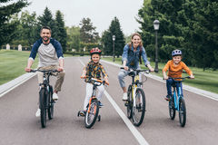 Happy family riding bicycles and spending time together Stock Photography