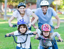 Happy family riding a bike Royalty Free Stock Photos